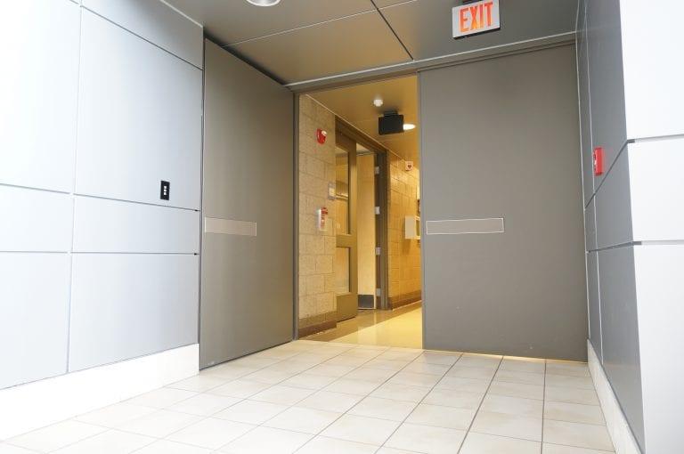 Pair of Total Doors in corridor with one leaf open