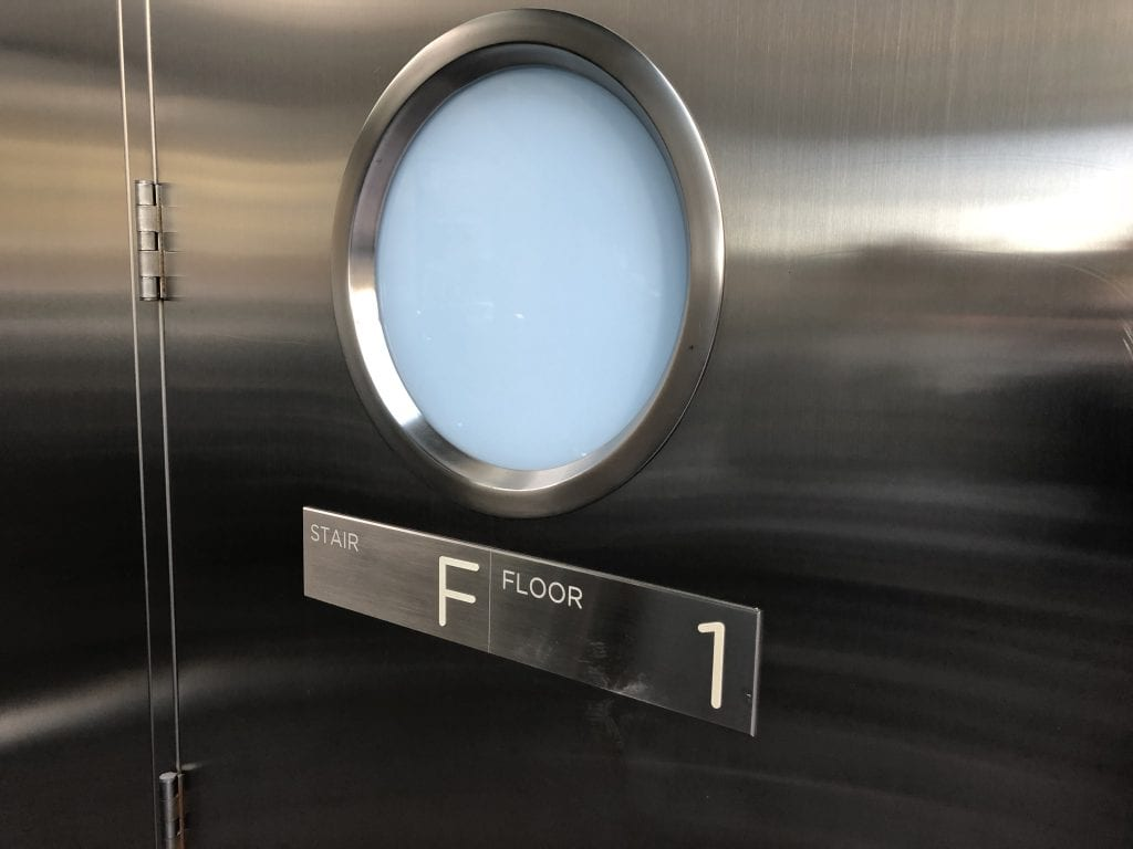 Stainless steel door with round door lite