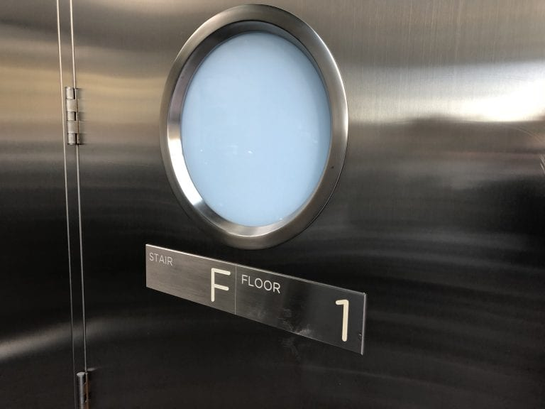 Stainless steel door with round door lite