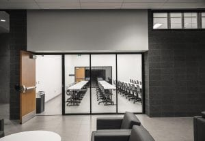 Classroom doors with exit devices and custom frames