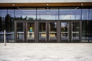 Bank of entry doors with full height pulls