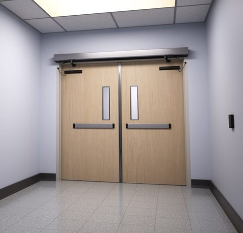Double automatic door operator on wood doors