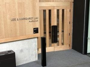 Auditorium entrance with bronze hardware