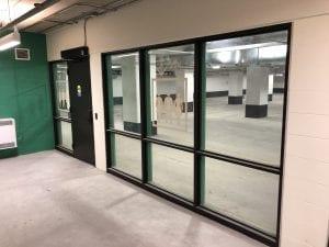 Custom screen and door in parking vestibule