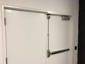 Top rod surface vertical rod exit device