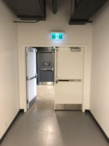 Exit pair with SVR exit devices and one leaf open