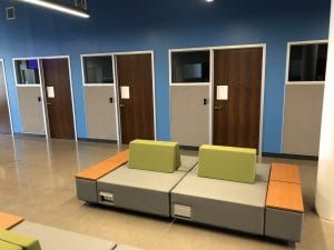 Office doors with furniture in foreground
