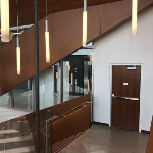 Wood door in feature stairwell