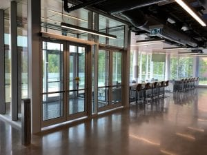 Entrance vestibule doors with exit devices
