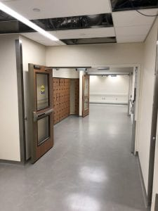 Corridor with automatic double egress doors