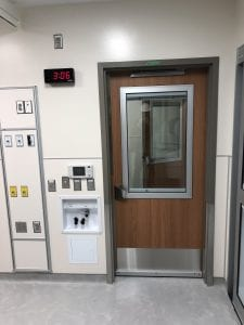 Hospital latch on door with integrated shutter