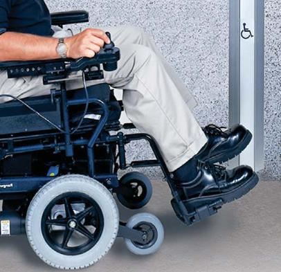 Person in wheelchair using WIKK pushbutton