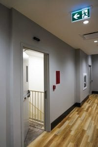 Open stairwell door with exit device and electric strike