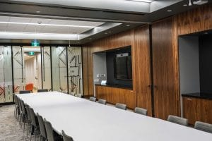 Meeting room with wood doors and panelling