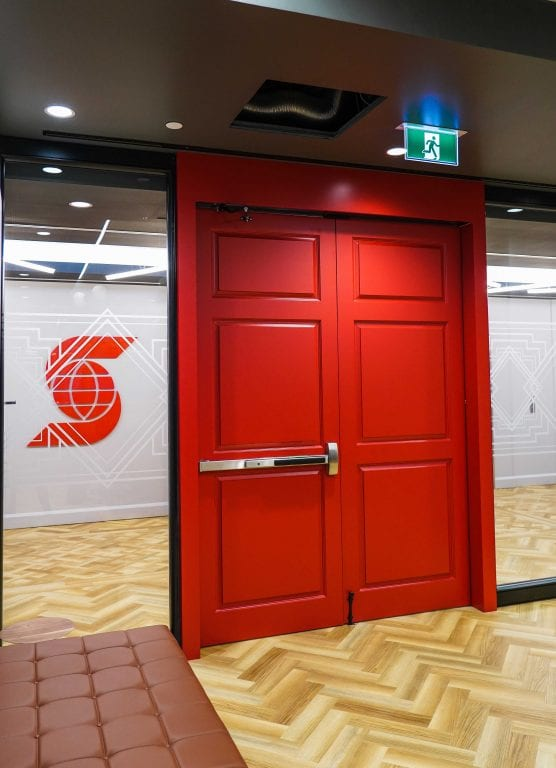 Red exit doors with Scotiabank logo in background