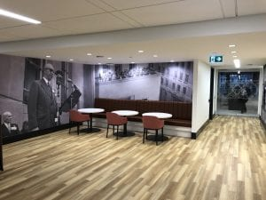 Seating area and glass door at Scotiabank Commons