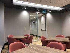 Exit door in sidelight frame
