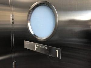 Stainles door - round lite detail