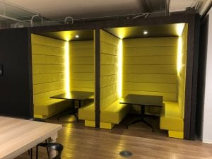 Bright yellow booths at cafeteria