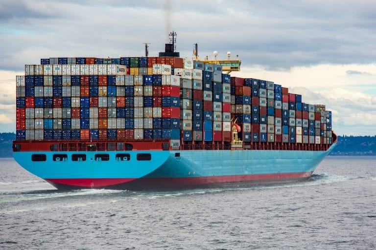 freighter loaded with shipping containers